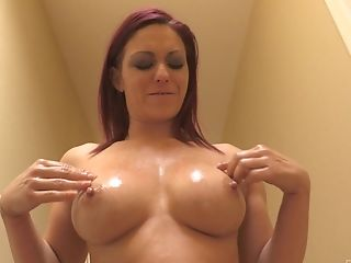 Oiled Up Red-haired Cougar Sarahb Plays With Her Big Tits In Public