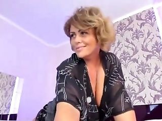 Horny Cougar Loves Her Magic Wand On Web Cam And Masturbates