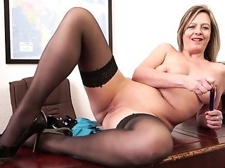 Matures Biz Woman Lou Pierce Gets Naked And Shows Striptease On The Table