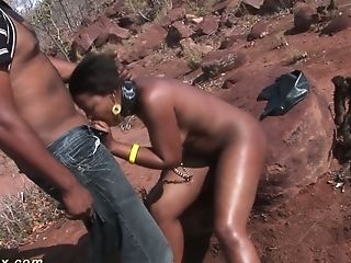 Two Non-traditional Dudes Fuck Trampy African Wild Bitch Right On The Stone